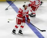 Tyler Bertuzzi of the Detroit Red Wings skates across the blue line during pre-game warmups before a game against the Tampa Bay Lightning.