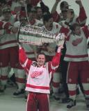 With the rest of the Red Wings in the background, Steve Yzerman lifts the Stanley Cup for the first time after the 1997 Finals.