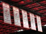 The banners for the Red Wings' 1955, 1997, 1998, 2002, and 2008 Stanley Cup Championships hanging in the rafters at Little Caesars Arena.