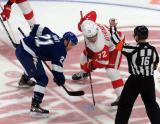 Brayden Point of the Tampa Bay Lighting lines up for a faceoff against Andreas Athanasiou of the Detroit Red Wings.
