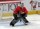 Drew DeRidder gets set in his crease during pre-game warmups before a scrimmage at the Detroit Red Wings' 2019 Development Camp.