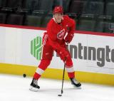 Moritz Seider skates near the boards during pre-game warmups before a scrimmage at the Detroit Red Wings' 2019 Development Camp.
