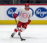 Charle-Edouard D'Astous skates with a puck during pre-game warmups before a scrimmage at the Detroit Red Wings' 2019 Development Camp.