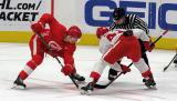 Chase Pearson takes a faceoff against Mathieu Bizier during a scrimmage at the Detroit Red Wings' 2019 Development Camp.