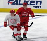 Thomas Casey and Jonatan Berggren collide in the neutral zone during a scrimmage at the Detroit Red Wings' 2019 Development Camp.