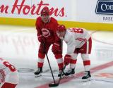 Ryan Kuffner and Owen Robinson line up for a faceoff during a scrimmage at the Detroit Red Wings' 2019 Development Camp.