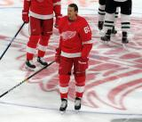 Danny DeKeyser of the Detroit Red Wings skates at center ice during pre-game warmups before a game against the Dallas Stars.
