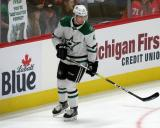 Miro Heiskanen of the Dallas Stars skates near the boards during pre-game warmups before a game against the Detroit Red Wings.