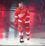 Filip Hronek of the Detroit Red Wings skates onto the ice during player introductions before the Red Wings' home opener against the Dallas Stars.