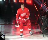 Anthony Mantha of the Detroit Red Wings skates onto the ice during player introductions before the Red Wings' home opener against the Dallas Stars.