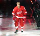 Valtteri Filppula of the Detroit Red Wings skates onto the ice during player introductions before the Red Wings' home opener against the Dallas Stars.