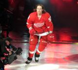 Tyler Bertuzzi of the Detroit Red Wings skates onto the ice during player introductions before the Red Wings' home opener against the Dallas Stars.