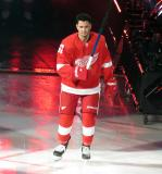 Taro Hirose of the Detroit Red Wings skates onto the ice during player introductions before the Red Wings' home opener against the Dallas Stars.