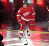 Christoffer Ehn of the Detroit Red Wings skates onto the ice during player introductions before the Red Wings' home opener against the Dallas Stars.