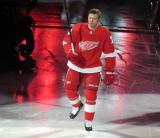 Christoffer Ehn of the Detroit Red Wings raises his stick to the crowd during player introductions before the Red Wings' home opener against the Dallas Stars.