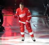 Adam Erne of the Detroit Red Wings skates onto the ice during player introductions before the Red Wings' home opener against the Dallas Stars.