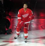 Madison Bowey of the Detroit Red Wings skates onto the ice during player introductions before the Red Wings' home opener against the Dallas Stars.