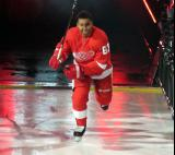 Trevor Daley of the Detroit Red Wings skates onto the ice during player introductions before the Red Wings' home opener against the Dallas Stars.