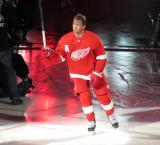 Justin Abdelkader of the Detroit Red Wings raises his stick to the crowd during player introductions before the Red Wings' home opener against the Dallas Stars.