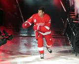 Dylan Larkin of the Detroit Red Wings skates onto the ice during player introductions before the Red Wings' home opener against the Dallas Stars.