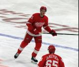 Dennis Cholowski of the Detroit Red Wings skates to the bench during a stop in play in a game against the Dallas Stars.