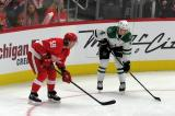 Tyler Bertuzzi of the Detroit Red Wings lines up on a faceoff opposite Miro Heiskanen of the Dallas Stars.