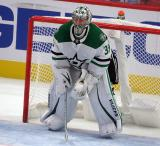 Anton Khudobin of the Dallas Stars crouches in his crease during a game against the Detroit Red Wings.