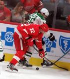 Patrik Nemeth of the Detroit Red Wings and Joe Pavelski of the Dallas Stars battle for the puck along the end boards.