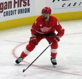 Luke Glendening of the Detroit Red Wings skates near the boards during a game against the Dallas Stars.