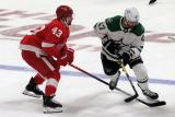 Darren Helm of the Detroit Red Wings defends against Alexander Radulov of the Dallas Stars.