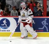 Filip Larsson of the Grand Rapids Griffins stands near the bench during pre-game warmups before a game against the Milwaukee Admirals.