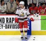 Filip Zadina of the Grand Rapids Griffins stands near the bench during pre-game warmups before a game against the Milwaukee Admirals.