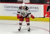 Ryan Kuffner of the Grand Rapids Griffins crouches near the boards during pre-game warmups before a game against the Milwaukee Admirals.