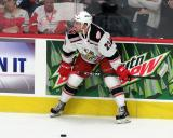 Dominic Turgeon of the Grand Rapids Griffins crouches near the boards during pre-game warmups before a game against the Milwaukee Admirals.