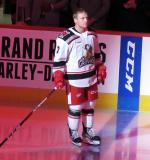 Joe Hicketts of the Grand Rapids Griffins stands at the blue line after being introduced before the team's home opener against the Milwaukee Admirals.