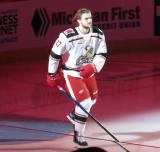 Michael Rasmussen of the Grand Rapids Griffins skates onto the ice during player introductions before the team's home opener against the Milwaukee Admirals.