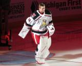 Filip Larsson of the Grand Rapids Griffins skates onto the ice during player introductions before the team's home opener against the Milwaukee Admirals.