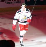 Mortiz Seider of the Grand Rapids Griffins skates onto the ice during player introductions before the team's home opener against the Milwaukee Admirals.