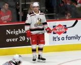Filip Zadina of the Grand Rapids Griffins stands near the boards during a stop in play in a game against the Milwaukee Admirals.