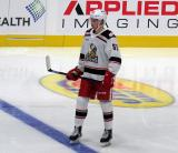 Moritz Seider of the Grand Rapids Griffins stands at the blue line during a stop in play in a game against the Milwaukee Admirals.