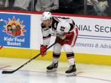 Dominik Shine of the Grand Rapids Griffins gets set for a faceoff during a game against the Milwaukee Admirals.