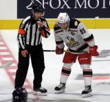 Matthew Ford of the Grand Rapids Griffins talks with an official during a stop in play in a game against the Milwaukee Admirals.
