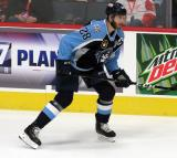 Jarred Tinordi of the Milwaukee Admirals skates near the boards during a game against the Grand Rapids Griffins.