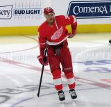 Madison Bowey of the Detroit Red Wings stands near center ice during pre-game warmups before a game against the Arizona Coyotes.