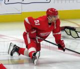 Valtteri Filppula of the Detroit Red Wings stretches near center ice during pre-game warmups before a game against the Arizona Coyotes.