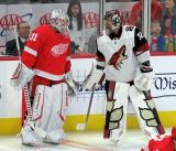 Calvin Pickard of the Detroit Red Wings and Antti Raanta of the Arizona Coyotes talk during pre-game warmups.
