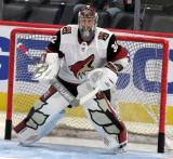Antti Raanta of the Arizona Coyotes gets set in his crease during pre-game warmups before a game against the Detroit Red Wings.