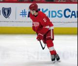 Filip Zadina of the Detroit Red Wings skates near the boards during pre-game warmups before a game against the Arizona Coyotes.