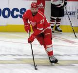 Brendan Perlini of the Detroit Red Wings skates with a puck during pre-game warmups before a game against the Arizona Coyotes.