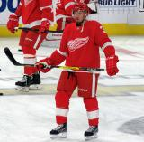 Alex Biega of the Detroit Red Wings stands in the neutral zone during pre-game warmups before a game against the Arizona Coyotes.